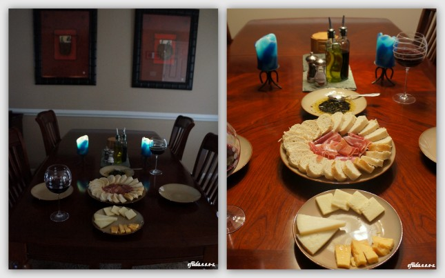 Romantic Candlelit dinner at home. – slices of Prosciutto (wild boar), French bread and olive oil with herbs dip, Manchego Cheese, Classic Vermont Cheddar Cheese (sharp), Old Amsterdam and Jam Jar (Sweet Shiraz, 2011).