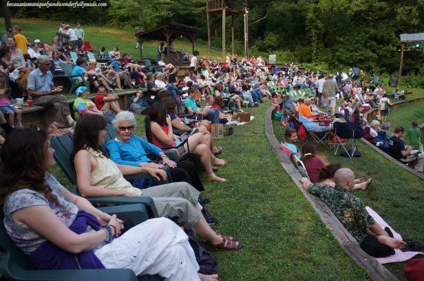 An excited crowd waiting for Much Ado About Nothing, a play under the stars in an open outdoor theatre in Asheville, North Carolina.