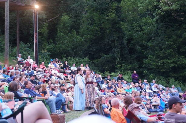 Two of the actresses interacting with the audience in Much Ado About Nothing, a play under the stars in an open outdoor theatre in Asheville, North Carolina.