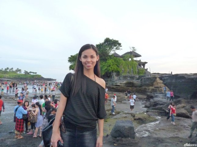 Tanah Lot in Bali, Indonesia is a popular rock formation shaped continuously over the years by the ocean tide with a temple built for worship of the Balinese gods.