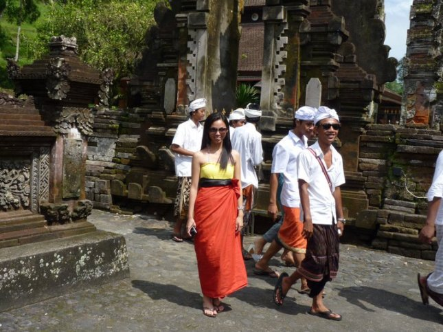 Everyone is required to wear a traditional Balinese sarong at Tirta Empul during Saraswati festival in Tampak Siring Village in Bali, Indonesia.