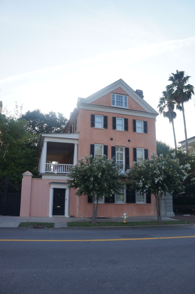 one of the beautiful pastel houses in Charleston, South Carolina with a unique character