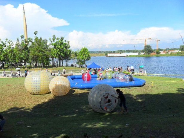 Zorbing balls during the annual Hot Air Balloon Festival in Putrajaya, Malaysia.