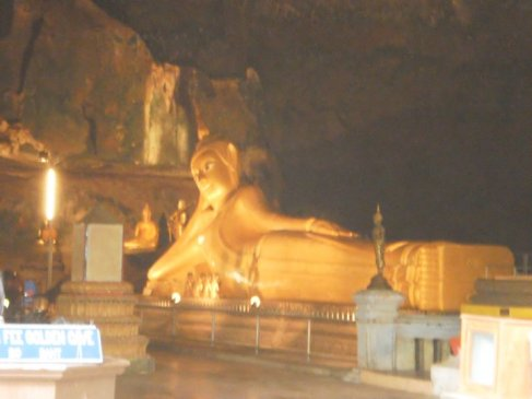 the giant buddha inside Wat Tham (meaning cave temple) Suwan Kuha, located in Phang Nga province, North of Phuket