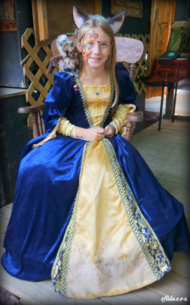 A kid dressed as a royalty at Michigan Renaissance Faire.