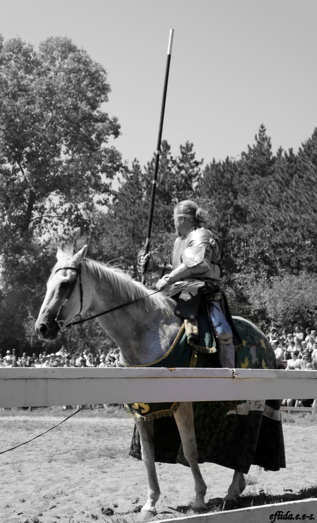 Knight in shining armor during a joust at Michigan Renaissance Faire 2012 in Holly, Michigan.