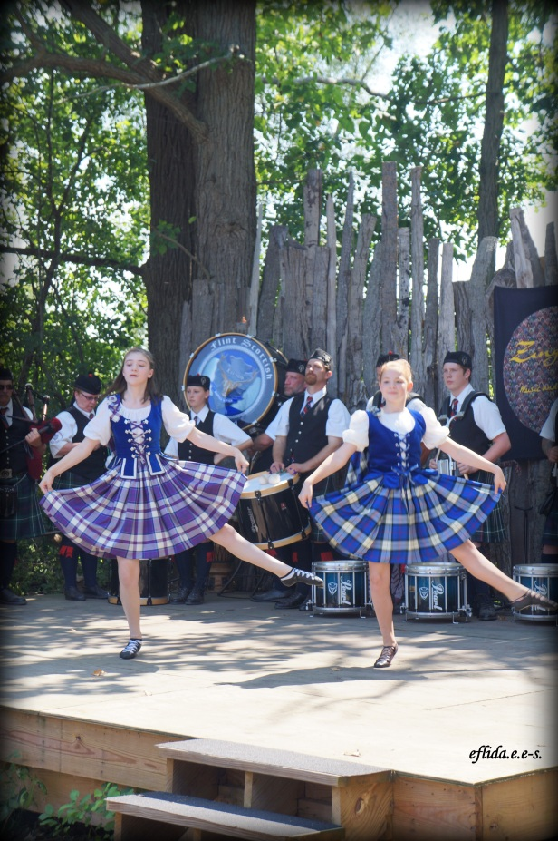 Ladies dancing to the music of Flint Scottish Pipe Band at Michigan Renaissance Faire.