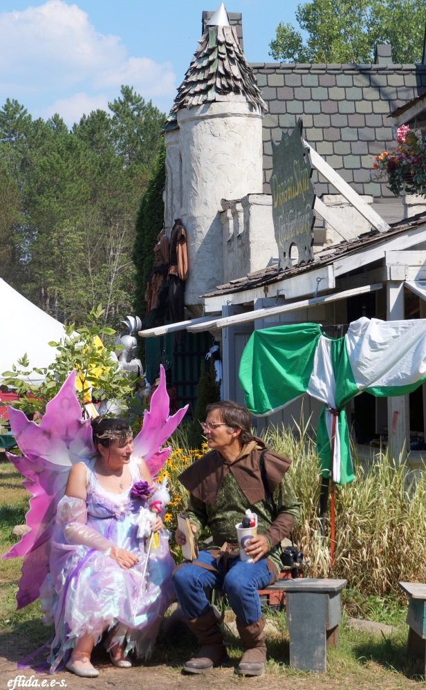 A fairy talking to a hunter at Michigan Renaissance Faire 2012.