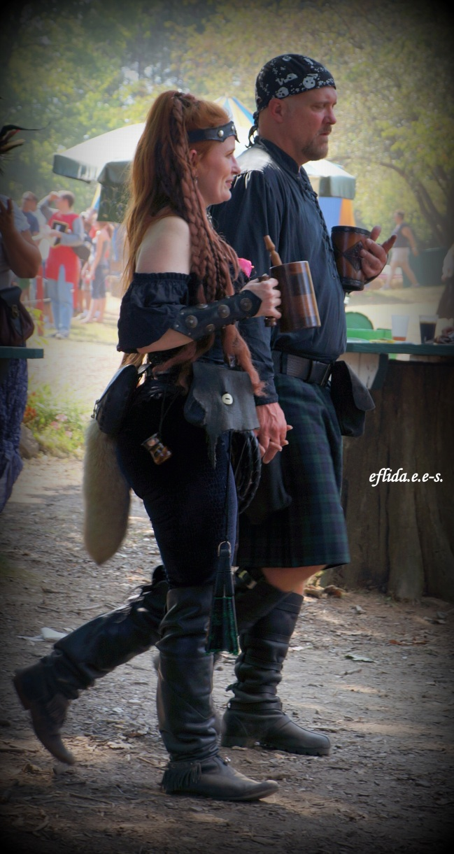 A couple enjoying the Michigan Renaissance Faire.