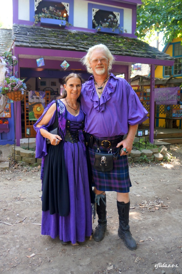 A couple dressed in purple garb at Michigan Renaissance Faire.