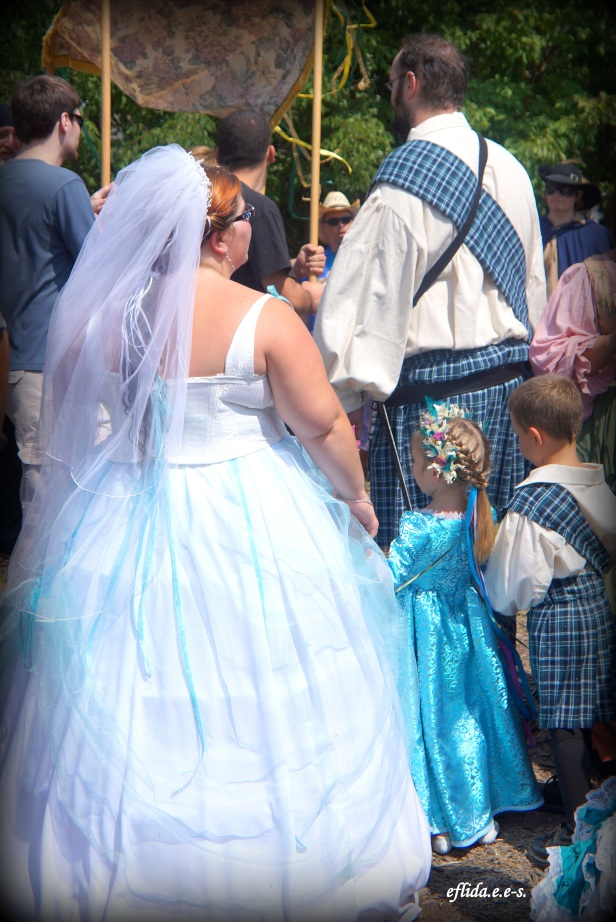 A couple exchanging marriage vows at Michigan Renaissance Faire.