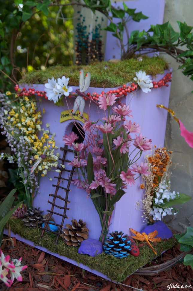 A fairy house with pine cones at Michigan Renaissance Faire 2012.