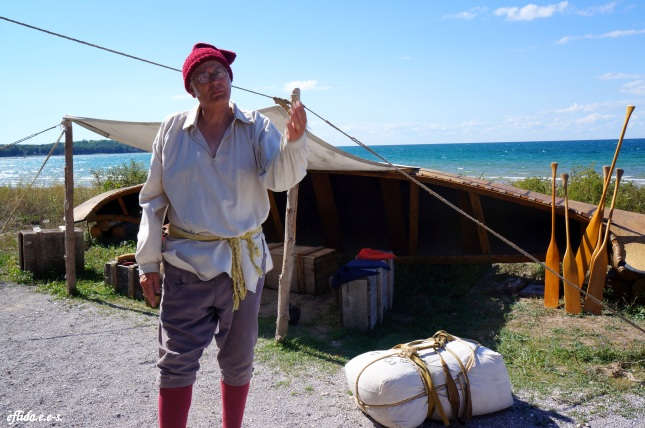 An actor playing as a French trader at Fort Michilimackinac, Michigan.
