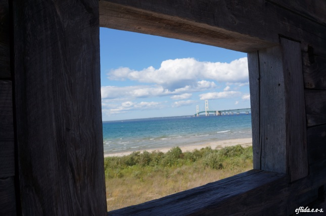 Peek of Lake Michigan and Mackinac Bridge from Fort Michilimackinac watchtower.