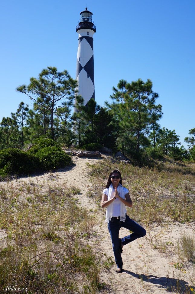 Tree pose at Cape Lookout Lighthouse in Southern Outer Banks, North Carolina.