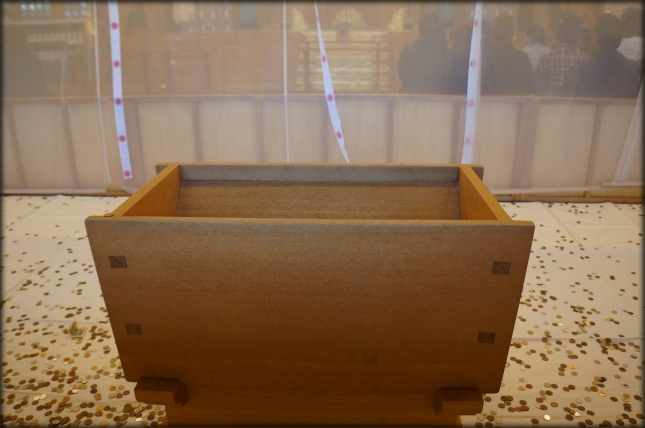 Osaisenbako is a large rectangular wooden offertory box where you toss some coins, a practice believed to remove bad luck.