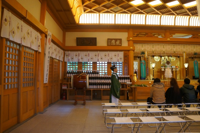 The priest inside the haiden at Futenma Shrine, Ginowan in Okinawa, Japan during hatsumode.