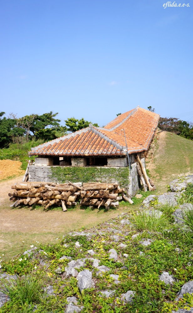 The red-tiled kiln with a number of linked chambers is located in the middle of the village in Yomitan, Okinawa, Japan.