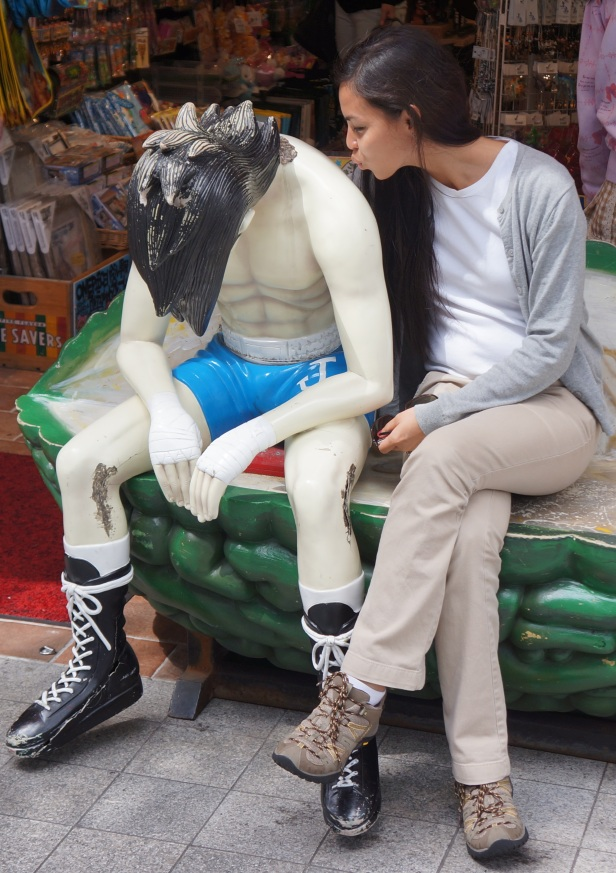 Kissing a life-size anime at one of the souvenir shops in Naha City, Okinawa, Japan.