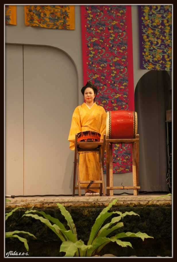 A female musical artist performing live at Ryukyu Mura in Okinawa, Japan.