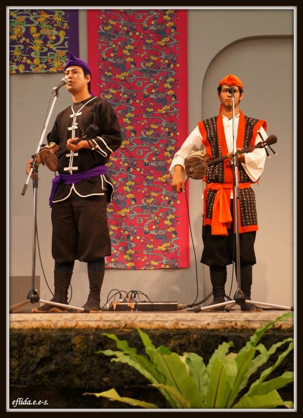 Male musical artists performing live at Ryukyu Mura in Okinawa, Japan.