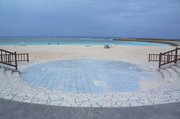 An open amphitheater with a full view of the beautiful Tropical Beach at Ginowan Seaside Park in Okinawa, Japan.