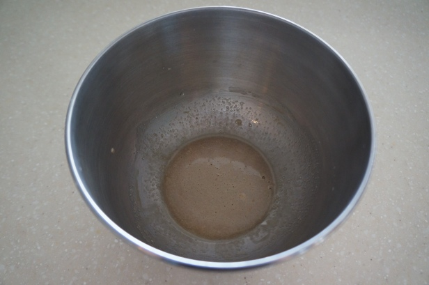 Mixed yeast and warm water for naan bread making.