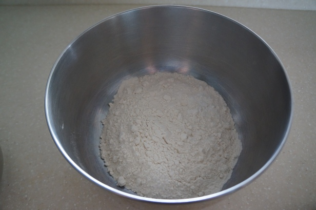 Mixed flour, salt and baking powder for naan bread making.