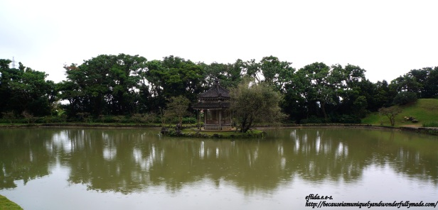 The hexagonal pavilion in the middle of the pond at Shikinaen Garden in Okinawa, Japan.