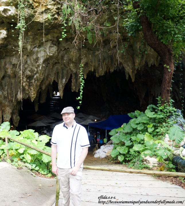 Hubby standing in front of the entrance of the cave where the Valley of Gangala in Okinawa, Japan experience begins.