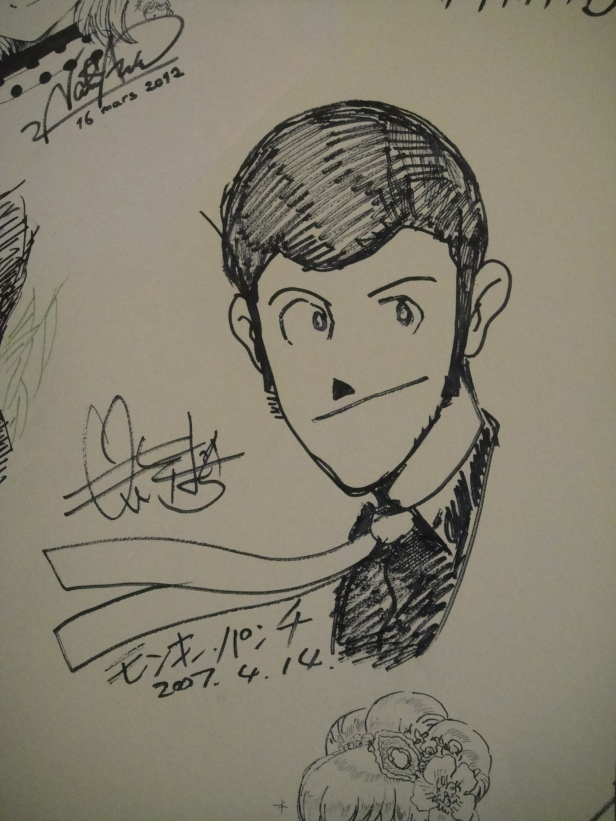 An autographed Lupin III illustration by its creator Monkey Punch at Kyoto International Manga Museum.
