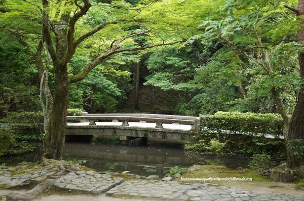 The stone bridge over Hojo-ike pond at Honen-in Temple in Kyoto, Japan.