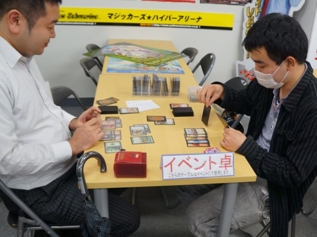 A glimpse of some Otakus playing cards inside one of the shops at Akihabara in Tokyo, Japan.