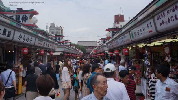 The very crowded Nakamise Dori leads to the temple's famous Sensoji's Sanmon called Hozomon Gate. Nakamise Dori is lined with shops seling various items from food to souvenirs in Tokyo, Japan.