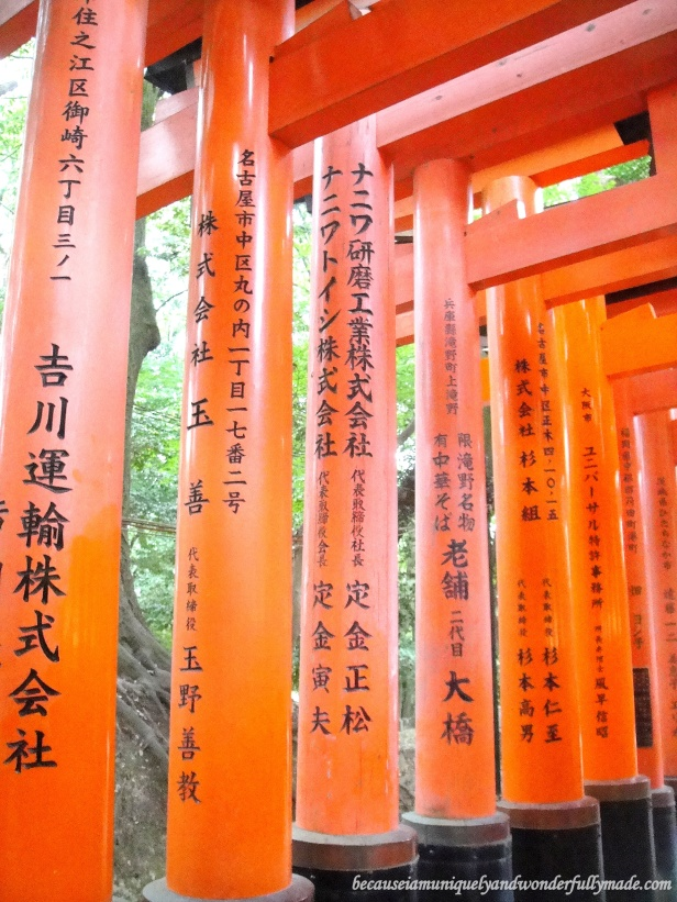 "A closer view of the names of the donor and the date of the donation that are inscribed on the back of each gate in one of the Senbon Torii 千本鳥居 in Kyoto, Japan. Senbon Torii means ""thousands of torii gates""."