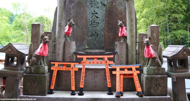 Foxes, instead of the common komainu dogs, are used at Fushimi Inari Shrine because foxes, specifically white foxes, are believed to be the messenger of deity Inari.