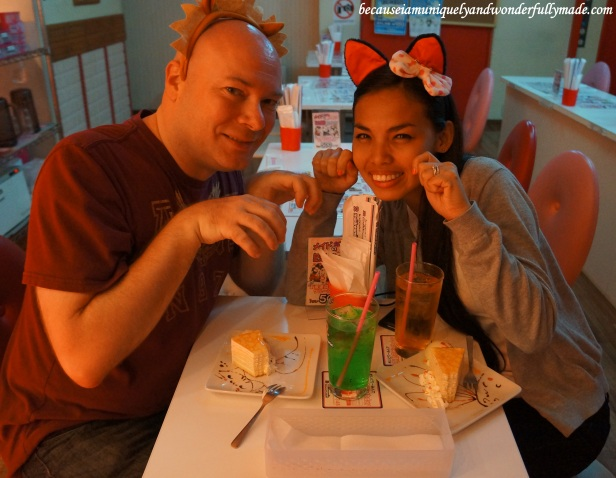 Myself wearing a headband of animal ear with a bow and my hubby wearing a headband of lion hair on our first maid cafe メイド喫茶 / メイドカフェ experience at Maidreamin Cafe メイドカフェ めいどりーみん at Akihabara District in Tokyo, Japan.
