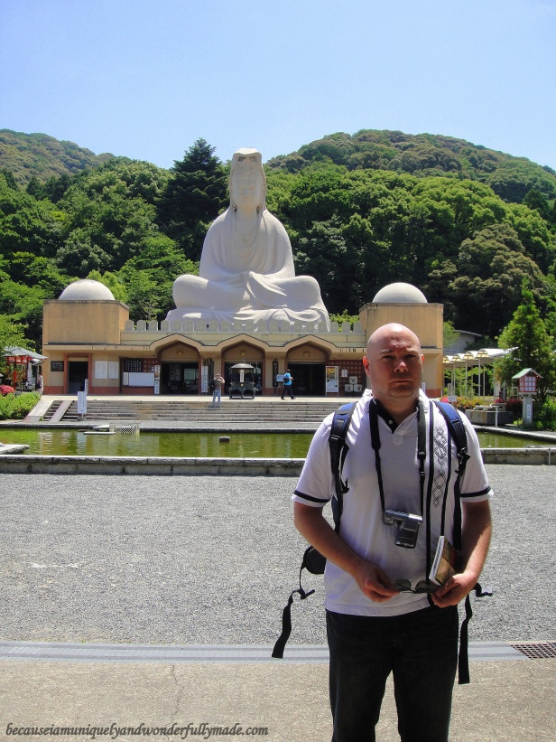 Hubby with the enormous concrete and steel statue of the Bodhisattva Avalokiteśvara (Kannon) in the background at Ryōzen Kannon 霊山観音 in Kyoto, Japan. The statue is 24 m high and is said to weigh 500 tons.