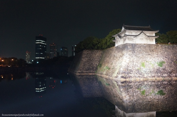 Osaka Castle 大坂城 with the city lights in the background in Chūō-ku, Osaka, Japan.