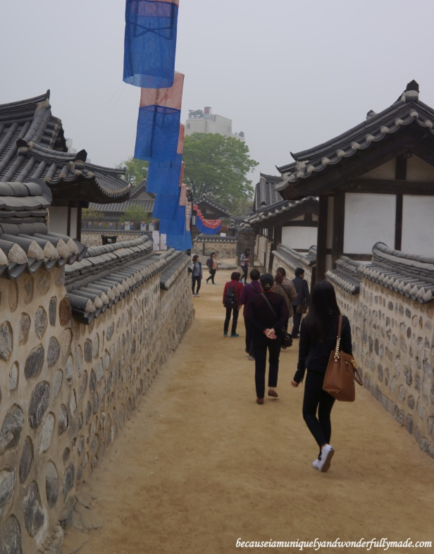 Walking along the stone walls at Namsangol Traditional Village in Jung-gu, Seoul, South Korea.