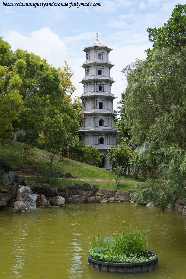 The Chinese pagoda and the pond at Fukushuen Garden 福州園 in downtown Naha 那覇市 Okinawa 沖縄本島,  Japan 日本国.