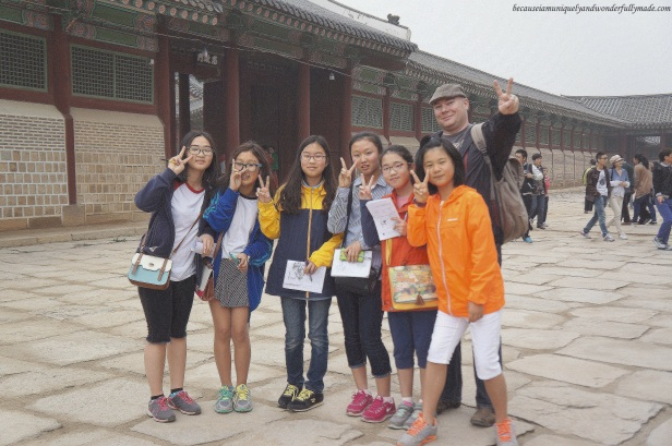 Korean kids being friendly to my husband at Gyeongbokgung Palace 경복궁 in Seoul, South Korea.