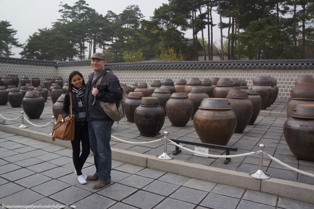 Behind us are fermented soy paste in clay pots at Gyeongbokgung Palace 경복궁 in Seoul, South Korea.