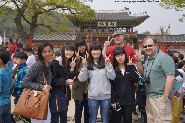 Korean girls politely asked us for a photo in after watching the 24 Martial Arts Trial Performance (무예24기 시범공연) in front of Sinpungnu Pavilion 신풍루 at Hwaeseong Haenggung Palace 화성행궁 – Suwon 수원, South Korea