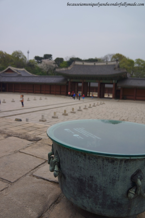 The big bowls on top of the stone platform in front of the Injeongjeon Hall at Changdeokgung Palace 창덕궁 complex are called Deumeu  드므 and were meant to put out fire.
