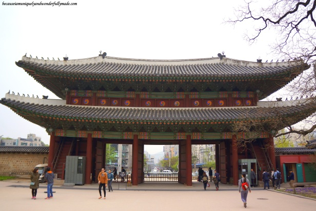 View of Donhwamun Gate 돈화문 looking out from the inside of Changdeokgung Palace 창덕궁 complex in Seoul, South Korea.
