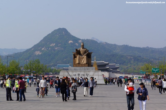 At the center of Gwanghwamun Square is the statue of King Sejong the Great 장헌대왕; 莊憲大王 , the fourth and most respected king of the Joseon Dynasty and creator of the Hangul (Korea's alphabet).  Gwanghwamun Gate is seen in the background.