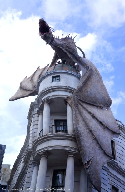 The iconic Ukranian Ironbelly dragon sitting atop the Gringotts bank at Diagon Alley in Harry Potter World in Orlando, Florida.