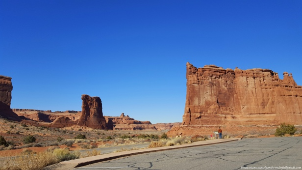 The Courthouse Towers Viewpoint at Arches National Park in Utah is where the famous rock formations called Three Gossips, Sheep Rock, the Organ, and the Tower of Babel can be viewed closely.