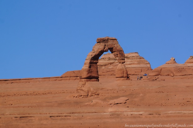 Capturing the view of Utah's famous Delicate Arch from Delicate Arch Viewpoint through a telephoto lens. The Viewpoint hike is the shorter and easier trial but offers a more distant view of the arch compared to the Delicate Arch Trail.